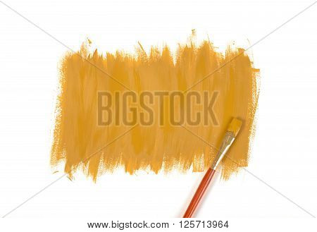 Color of mustard gouache hand-painted daub with used paint brush