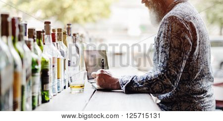 Senior Man Writing Working Liquor Alcohol Bar Concept