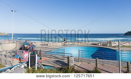 Sydney - March 1 2016: beautiful Sate Park with interesting slides in the beautiful city beach and people swimming in the sea March 1 2016 Sydney Australia