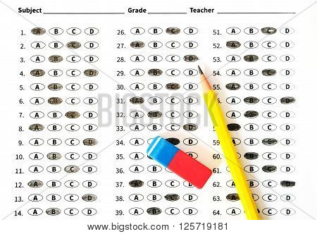 Education test sheet with yellow pencil. Education concept