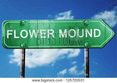 flower mound road sign on a blue sky background