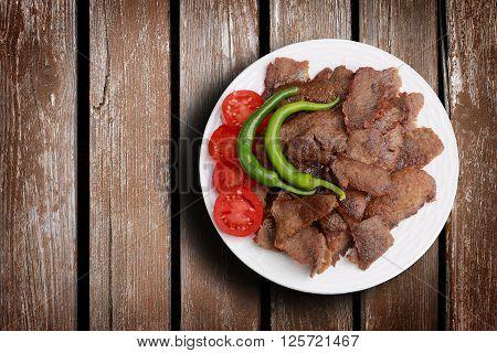 Traditional turkish doner kebab. Donner kebab on a wood background.