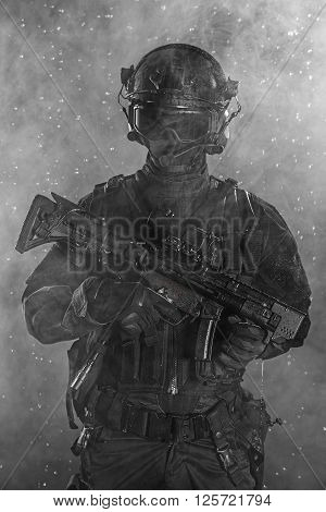 Police officer SWAT in black uniform in the smoke
