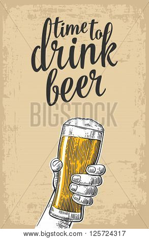 Male hand holding a beer glass. Vintage vector engraving illustration for web poster invitation to party - time to drink. Isolated on baige old paper texture background.
