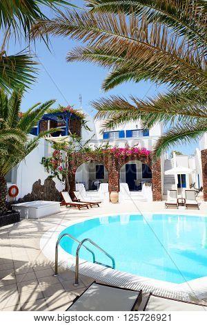Swimming pool of hotel in traditional Greek style Santorini island Greece
