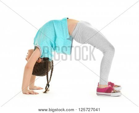 Little cute girl practicing yoga pose, isolated on white