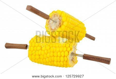 Two cooked sweet corn portions with wooden handled forks isolated on a white background