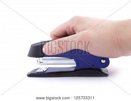 Hand holding blue stapler isolated on white