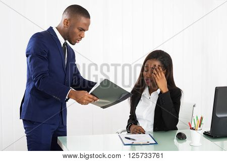 Boss Showing Document To Her Female Executive