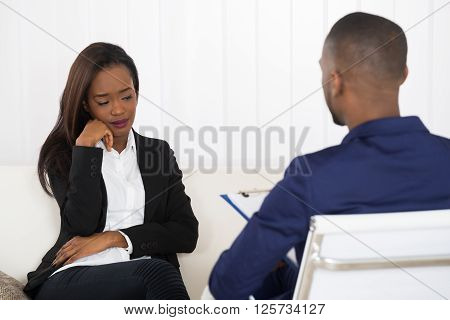 Young Woman And Psychiatrist