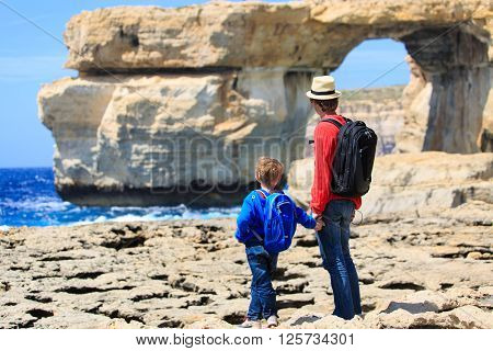 father and son looking at scenic mountains in Gozo island, Malta
