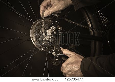 Man Installing Bicycle Chain On Gear Closeup
