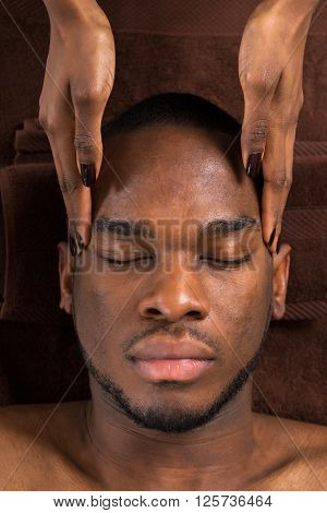 Man Getting Forehead Massage In Spa