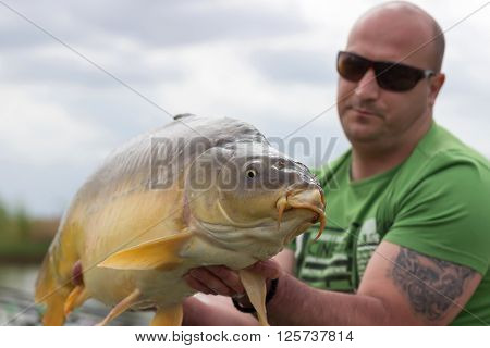 Carp and Fisherman, Carp fishing trophy