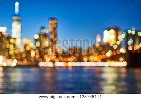 Defocused view of New-York City downtown from Brooklyn at evening