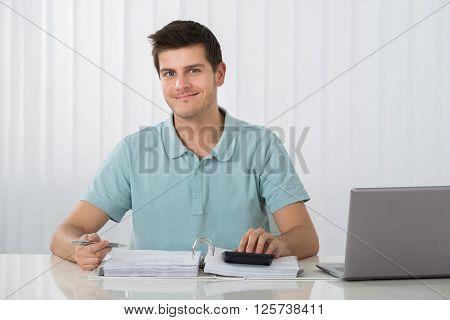 Man Calculating Tax