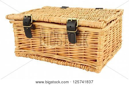 Woven wicker basket with straps and buckles isolated on a white background