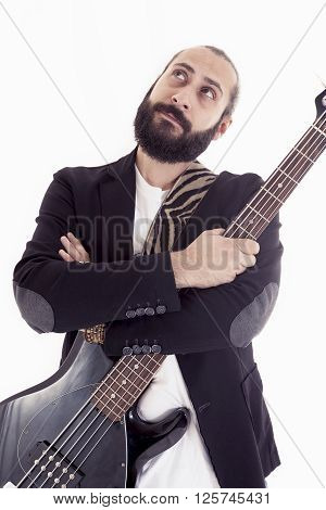 Studio Portrait Of Young Bass Player On White Background