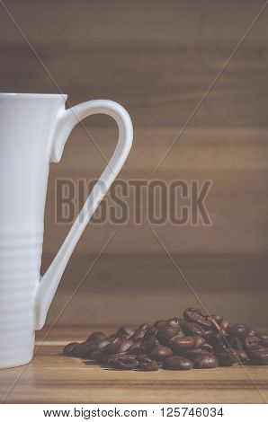 Vintage style image of a coffee mug and coffee beans