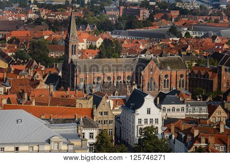 Wide angle panoramic view from above the top of Belfry vantage point to roofs of ancient medieval Europe city Bruges