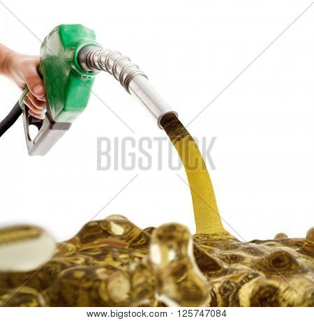Male hand pumping gasoline in a tank isolated on white