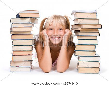 Back to School Concept.School Girl between the stacks of books.