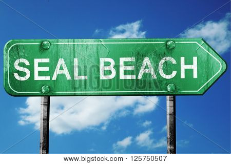 seal beach road sign on a blue sky background