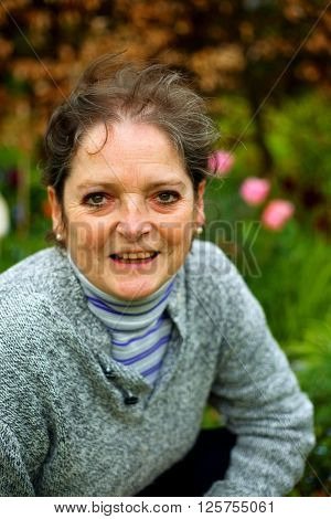Happy mature woman gardener