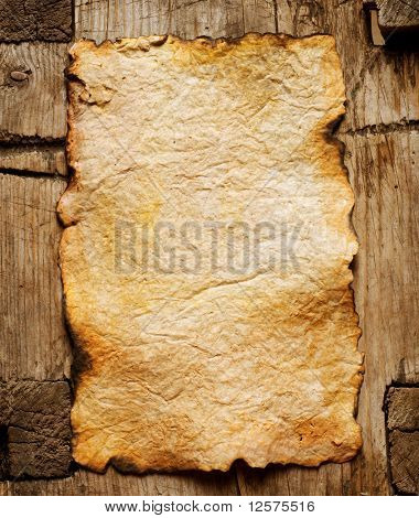 Old Paper sheet over wooden background