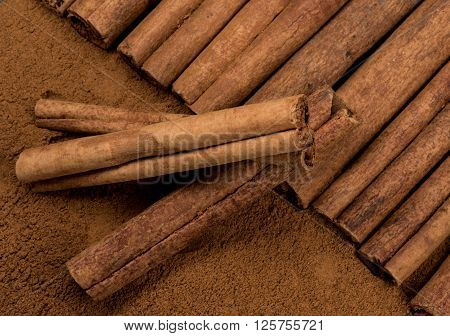 Cinnamon Sticks Laying Atop Ground Cinnamon With Three Sticks Askew