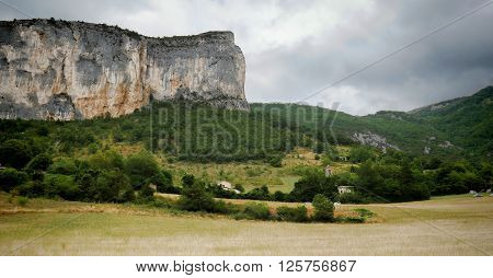 a landscape with a rocky cliff in France
