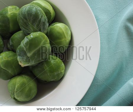 Brussels Sprouts uncooked in a white bowl