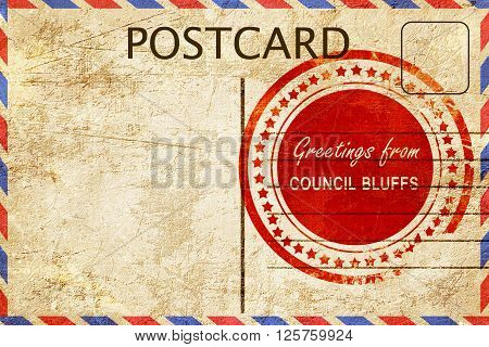 greetings from council bluffs, stamped on a postcard