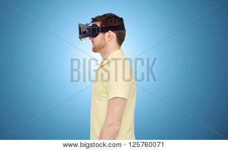 3d technology, virtual reality, entertainment and people concept - young man with virtual reality headset or 3d glasses over blue background
