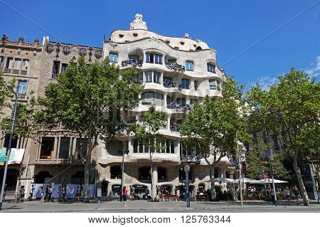 BARCELONA, SPAIN - AUGUST 1, 2015: Casa Mila or known as La Pedrera, designed by Antoni Gaudi, Barcelona, Spain