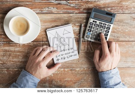business, education, people and technology concept - close up of male hands with calculator, pen and notebook solving geometric task