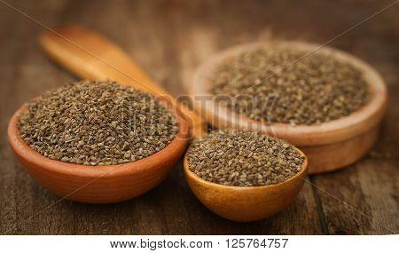 Ajwain seeds in bowl and wooden spoon
