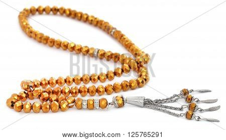 Close up of rosary over white background