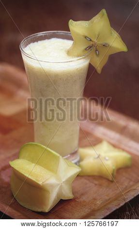 Carambola or star fruits juice over white background