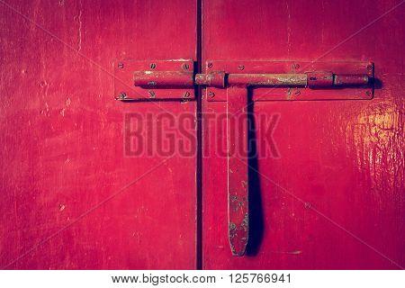 Red Metal Door Closed With Door Handle Lock