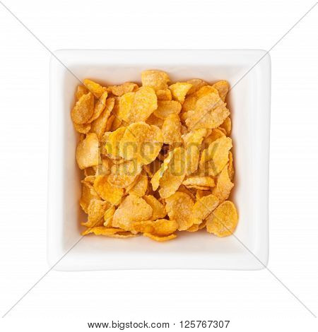 Corn flakes in a square bowl isolated on white background