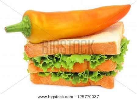 Green Lettuce in a bread with banana chilli over white background