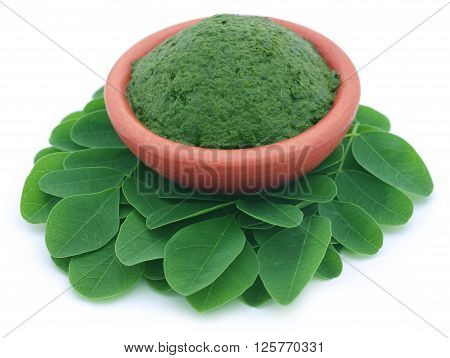 Close up of edible moringa leaves with mashed ones