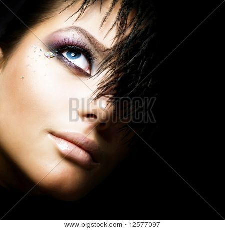 Fashion Girl's Face.Perfect makeup.Isolated on Black
