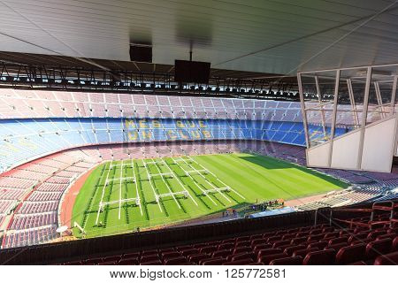 Barcelona, Spain - November 12, 2015: Football stadium Camp Nou interior panorama with grass field, stands and commentators boxes. The stadium has been the home of FC Barcelona since its completion in 1957.