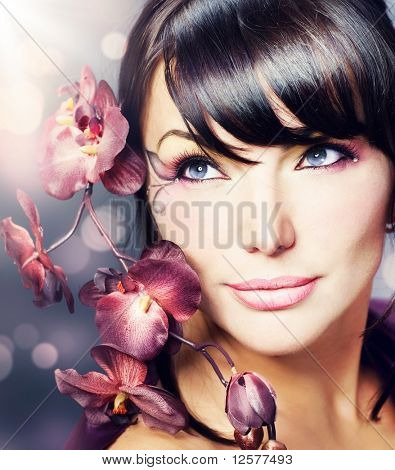 Beautiful Healthy Woman with Orchid flower