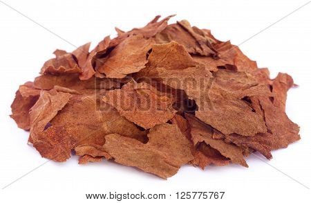 Pieces of dry tobacco leaves over white backgrouknd