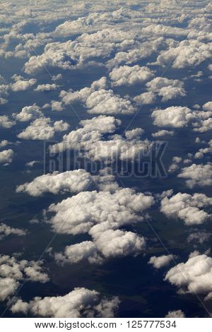Top view on clouds and fields in nice day