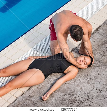 Lifeguard Placing Victim In Recovery Position