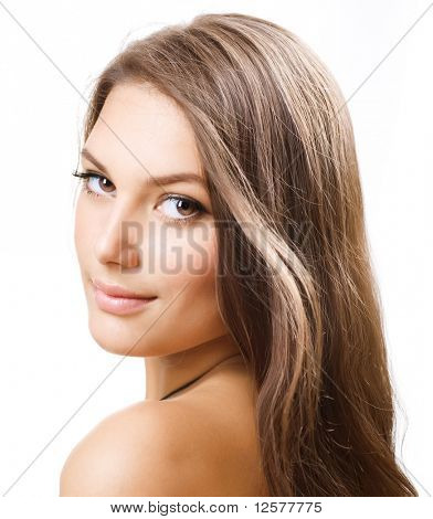 Beautiful Girl with long hair. Portrait over white.Perfect Skin
